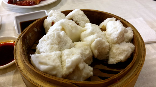Steamed BBQ Pork Buns or Char Siu Bao. This one is barbecue pork buns filled with barbecue flavored char siu pork. These fluffy buns are made from wheat flour and steamed so they are fresh and hot when served.